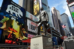 NYC: George M. Cohan Statue in Times Square. Statue of Broadway's legendary showman George M. Cohan stands in the center of Times Square amidst all the hustle Royalty Free Stock Photo