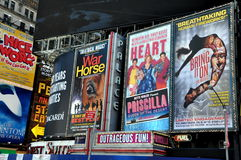 NYC: Giant Billboards in Times Square. Giant billboards for Broadway shows cover the facades of buildings on 7th Avenue in the heart of NYC's Times Square royalty free stock photo