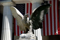 NYC:  Grant\'s Tomb Eagle. One of the two great American eagle sculptures in front of Grant's Tomb on Riverside Drive with American flags in the background in Stock Photography
