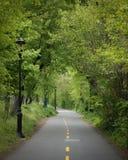 NYC greenway bike path through Fort Washington Park on a dark au stock photography