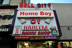 NYC: Harlem Pawn Shop. A prominent sign hangs above the entrance to the Home Boy of Harlem Pawn Shop on West 125th Street in NYC's Harlem Stock Image