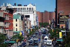 NYC: Harlem's 125th Street. View along  bustling 125th Street choked with traffic, the very heart and soul of Harlem, with the legendary Theresa Hotel (large Royalty Free Stock Photo