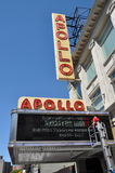 NYC:  Harlem's Famed Apollo Theatre. A worker checks light bulbs on the marquee sign at the world-famous Apollo Theatre on West 125th Street in the heart of New Royalty Free Stock Images
