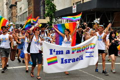 NYC: Israeli Marchers at Gay Pride Parade. Gay Israelis marching with their flag in the 2013 Gay Pride Parade on NYC's Fifth Avenue Royalty Free Stock Photography
