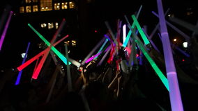 The 2014 NYC Lighsaber Battle 8. A lightsaber duel occurs when two or more combatants armed with lightsabers, or when one party using lightsabers against another Stock Photography