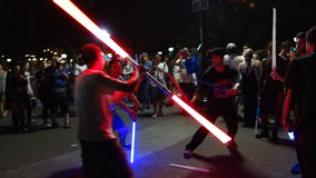 The 2014 NYC Lighsaber Battle 20. A lightsaber duel occurs when two or more combatants armed with lightsabers, or when one party using lightsabers against Royalty Free Stock Photography