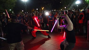The 2014 NYC Lighsaber Battle 34. A lightsaber duel occurs when two or more combatants armed with lightsabers, or when one party using lightsabers against Stock Image