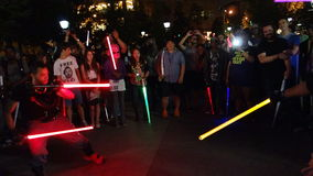 The 2014 NYC Lighsaber Battle 37. A lightsaber duel occurs when two or more combatants armed with lightsabers, or when one party using lightsabers against Royalty Free Stock Photos