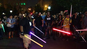 The 2014 NYC Lighsaber Battle 124. A lightsaber duel occurs when two or more combatants armed with lightsabers, or when one party using lightsabers against Stock Image