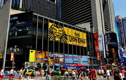 NYC: Lion King Billboard in Times Square. An enormous billboard for Disney's hit Broadway musical The Lion King and other advertising signs dominate building royalty free stock image