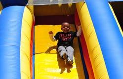 NYC: Little Boy on Plastic Slide Stock Image