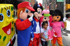 NYC: Little Girl with Cartoon Characters Royalty Free Stock Image