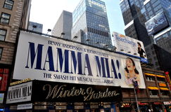 NYC: Mamma Mia Musical at Winter Garden Theatre. Giant billboard and the marquee of the historic Winter Garden Theatre for the smash hit musical Mamma Mia! which royalty free stock photos