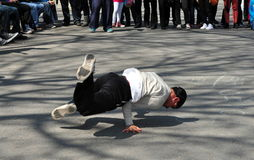 NYC: Man Breakdancing in Central Park Royalty Free Stock Photography