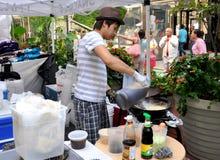 NYC: Man Cooking Thai Food Stock Photo