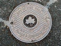 NYC manhole lid royalty free stock photos