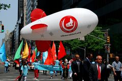 NYC: Marchers at Turkey Day Parade with Blimp. New York City: Inflated mini-blimp flies above marchers at the annual Turkish Day Parade on Madison Avenue Stock Photography