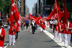 NYC: Marchers at Turkey Day Parade. New York City:  Marchers carrying Turkish and American flags at the annual Turkish Day Parade on Madison Avenue Royalty Free Stock Photos