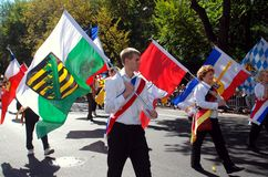 NYC: Marchers at Von Steuben Day Parade. NYC:  Marchers carrying colourful flags of German states at the annual Von Steuben Day Parade on Fifth Avenue Stock Photos