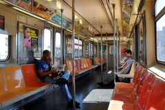 NYC: MTA Subway Car Interior. Interior of an almost empty MTA subway car on the #1 Broadway local IRT line which runs from Battery Park to West 242nd Street in Stock Photos