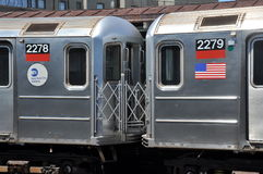 NYC: MTA Subway Cars 2278 & 2279. MTA cars #2278 amd 2279 coupling together, one bearing an American flag, on the #1 Broadway Local IRT Train at the West Stock Photography