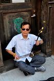 NYC: Musician Playing Erhu in Chinatown Royalty Free Stock Images