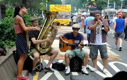NYC: Musicians at Street Festival. A group of four musicians entertaining passerby during an Upper West Side street festival on Broadway n New York City Stock Photos