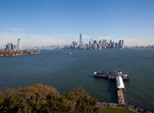 NYC and New Jersey skyline with ferry. From the base of the Statue of Liberty looking over to the lower Manhattan and New Jersey skyline as the Miss New York Royalty Free Stock Photos