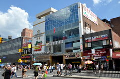 NYC:  New World Mall in Flushing. Busy Chinatown in Flushing (Queens), New York with the modern New World Mall on Main Street featuring a huge Jmart supermarket Stock Photo