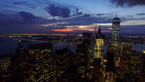 NYC New York City downtown skyscrapers in the bright night lights, amazing modern urban skyline in 4k aerian stock footage