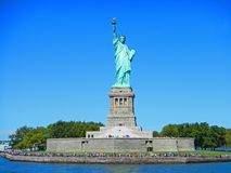 NYC New York city Statue of Liberty on Liberty island. Statue of Liberty National Monument and museum. Statue of Liberty island gr Stock Photos
