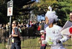 NYC Nov 7: runner in swan outfit NYC Marathon 2010. New York, NY November 7: Japanese runner wearing a swan outfit New York City Marathon 2010, motion blur stock photo