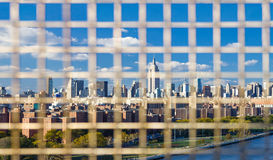NYC Panorama Downtown Skyline Background Through a Fence Stock Photography