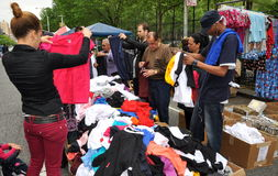 NYC: People Checking out Bargain Clothing. People pick through a pile of bargain clothing at an Amsterdam Avenue Street Festival in New York City being sold at Royalty Free Stock Images
