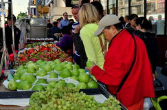 NYC: [People Shopping in Chinatown. People shopping for fresh fruits from a vendor's booth on busy Canal Street in the heart of NYC's Chinatown stock images