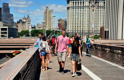 NYC: People Walking on Brooklyn Bridge Royalty Free Stock Images