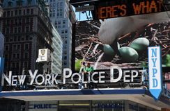 NYC:  Plainclothes Police in Times Square. Two plainclothes policemen standing on the roof of the NYPD Times Square station house keep a watch on the busy Stock Image