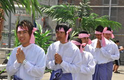 NYC: Praying Men at Burmese Water Festival Stock Photos