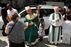 NYC: Priest Greeting Parishioners royalty free stock image
