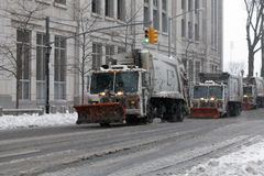 NYC Sanitation trucks plowing snow in the Bronx Royalty Free Stock Photo