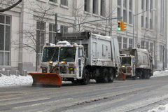 NYC Sanitation trucks plowing snow in the Bronx Stock Photos