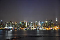 Nyc SKyline. Night shot of manhattan with lights reflecting on the river Stock Image