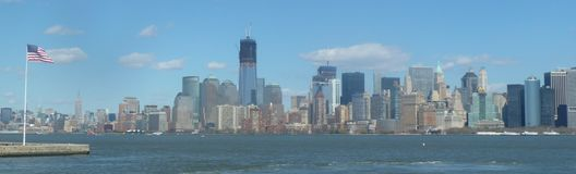 NYC Skyline with American Flag Royalty Free Stock Image