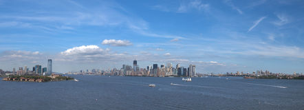 NYC Skyline Panorama. A panoramic view of New York City, USA, from the Statue of Liberty. On the left is Liberty State Park in New Jersey, in the center is the Stock Image