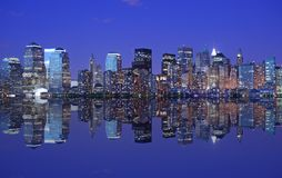 NYC skyline and reflection. Lights of NYC skyline and reflection just after sunset Royalty Free Stock Photography