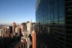 NYC Skyline with a reflection. New York City Skyline with a reflection on a close building Royalty Free Stock Photo