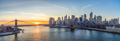 Nyc skyline at sunset. Over looking Manhattan skyline and brooklyn bridge with sunset Royalty Free Stock Image