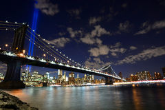 NYC skyline tribute lights. 9/11 WTC Memorial Light Tribute at Manhattan downtown with view of bridge Royalty Free Stock Photography