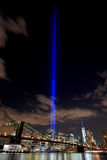 NYC skyline tribute lights. 9/11 WTC Memorial Light Tribute at Manhattan downtown with view of bridge Royalty Free Stock Photo