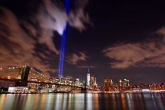 NYC skyline tribute lights. 9/11 WTC Memorial Light Tribute at Manhattan downtown with view of bridge Stock Photo